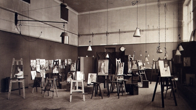 black and white photograph of Edinburgh College of Art Studio with student works on easels