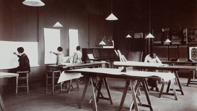 black and white photograph of four women in an Edinburgh College of Art studio undertaking interior design work, c.1910s
